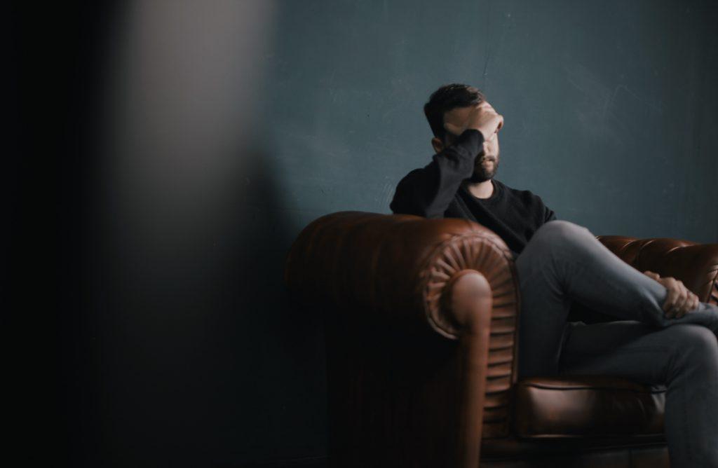 Sad man on couch